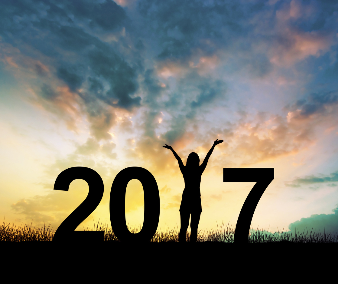 Silhouette young woman Enjoying on the hill and 2017 years while celebrating new year
