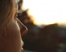 Beautiful woman looking outside