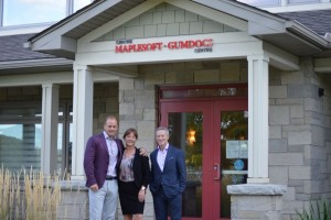 Jody Campeau (President & CEO of Maplesoft Group), Linda Eagen (President & CEO of the Ottawa Regional Cancer Foundation) and Cancer Champions Cabinet member Fred Seller outside the newly named Maplesoft-GumDocs Centre for Cancer Survivorship.